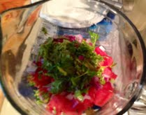 3.  Mix watermelon, diced red pepper, red onion, cilantro, cummin spice, oil and vinegar into large bowl
